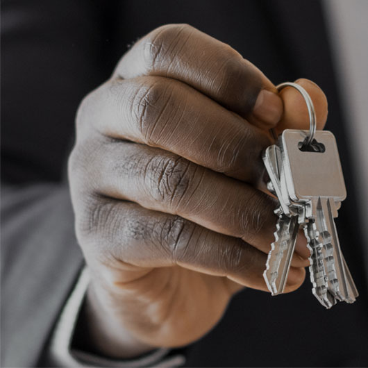 hand holding keys barriston real estate law